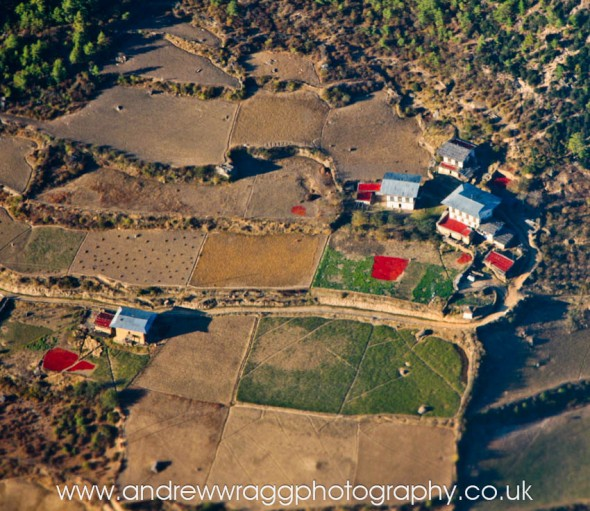 Bhutan - Aerial photo of houses and chillies drying
