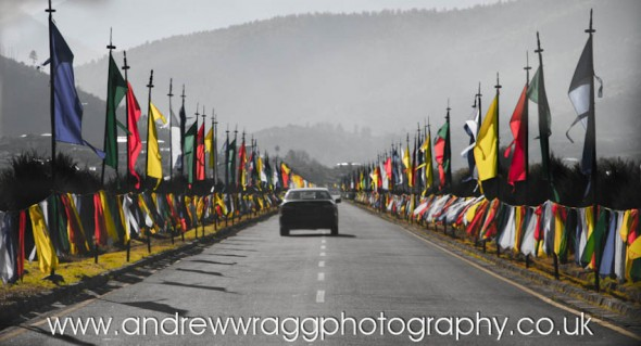 Bhutan - Coronation flags on the road to Paro airport