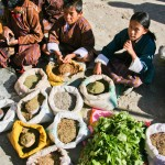 Young Bhutanese children selling grain at Paro market
