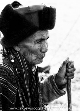 Old Bhutanese man watching an archery competition