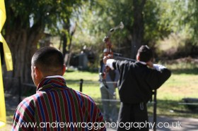 An archer draws his bow, ready to let his arrow fly